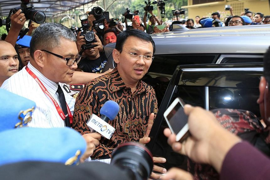 Mr Basuki (centre) speaking to journalists at the police headquarters in Jakarta on Monday. An opinion poll published on Thursday showed that his support has plunged from 60 per cent in March to 25 per cent.