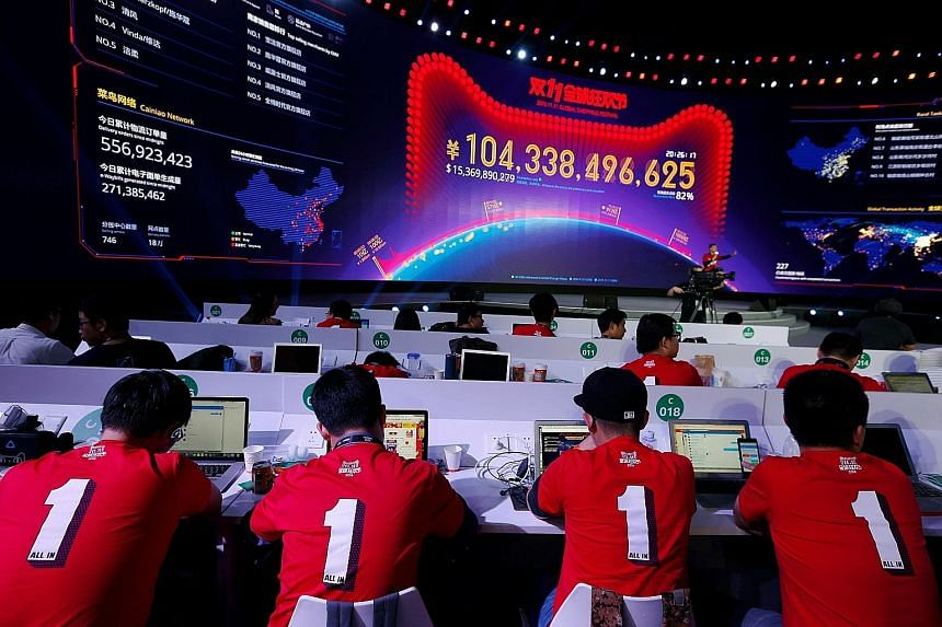 This screen at a media centre yesterday in Shenzhen, China, showing the value of goods being transacted during e-commerce giant Alibaba's Singles' Day global shopping festival. The figure has exceeded last year's total of 91.2 billion yuan (S$18.9 bi
