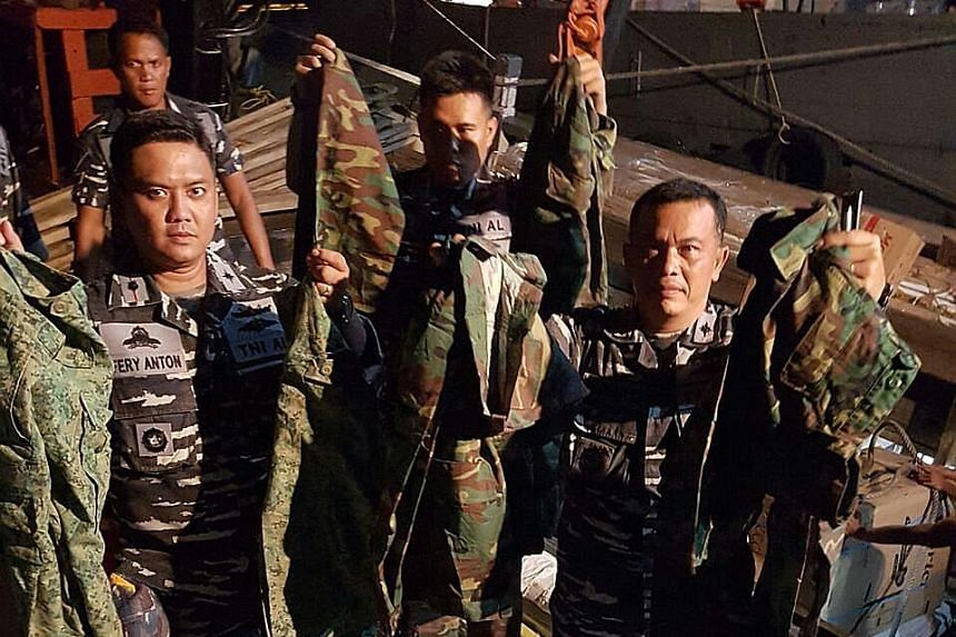 Green camouflage uniforms first issued by the SAF in 2008 and an older version with splotches of black, brown and green were found in a truck.