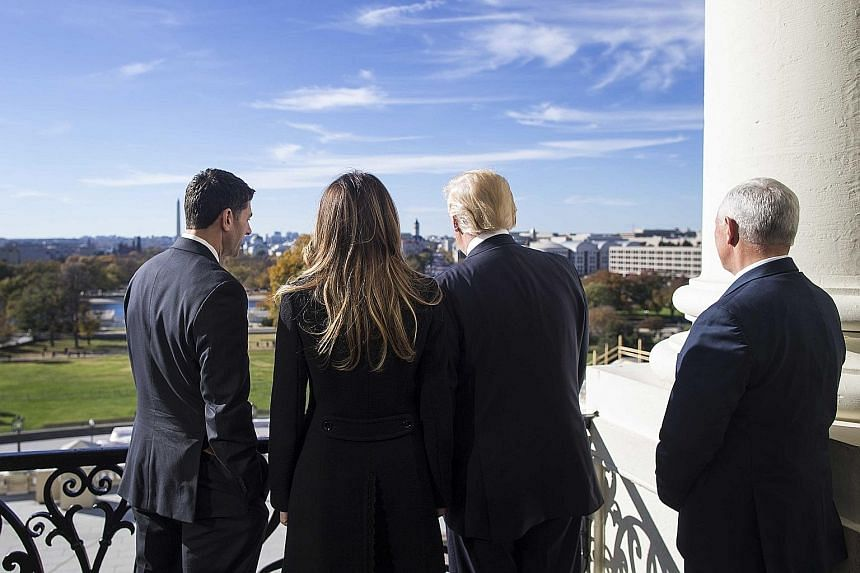 From left: House Speaker Paul Ryan, future First Lady Melania Trump, President-elect Donald Trump, and vice-president-elect Mike Pence on the Speaker's Balcony at the Capitol building in Washington on Thursday.