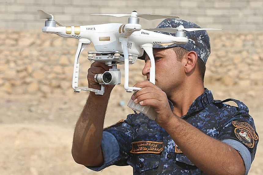 An Iraqi federal police officer using a drone during an operation against ISIS militants south of Mosul last month.