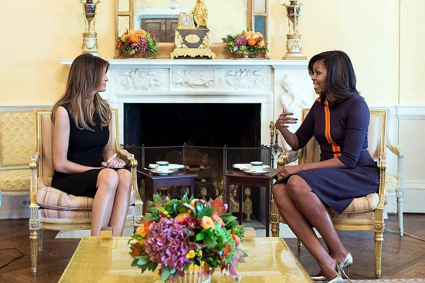 Above: Mrs Trump (left) and Mrs Obama meeting for the first time on Thursday. Left: Mr Trump later tweeted on their visit to the White House.