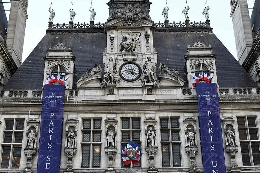 "Banners reading ""Paris remembers"" and ""Paris united"" are hung on the facade of the City Hall in Paris. Tomorrow, France will mark the first anniversary of coordinated terror attacks in and around Paris that left 130 people dead."