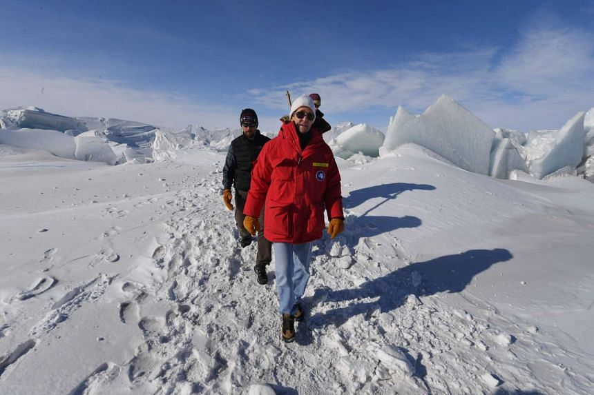 US Secretary of State John Kerry walking on a frozen section of the Ross Sea near the McMurdo Station, Antarctica on Nov 12, 2016.