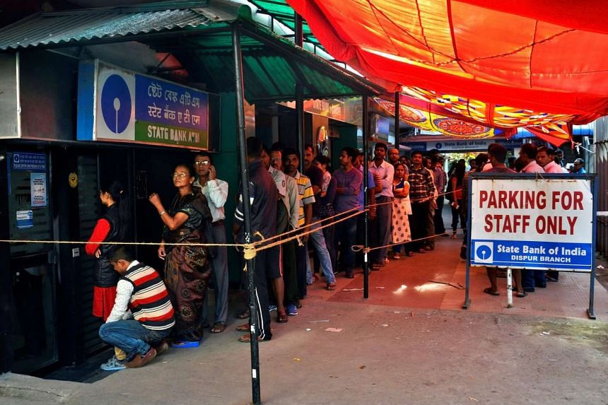 People queue to withdraw and deposit their money at State Bank of India ATM in Guwahati, India on Nov 11, 2016.