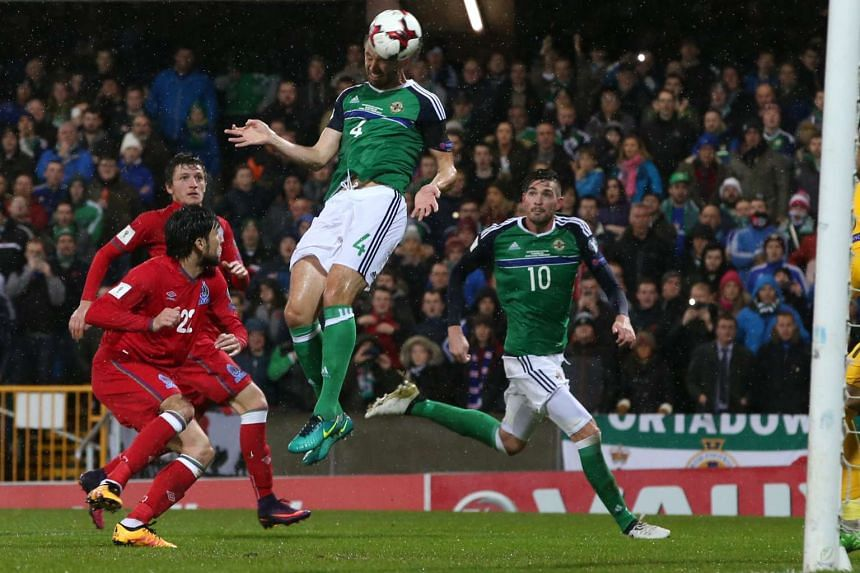 Northern Ireland's Gareth McAuley scoring their second goal.