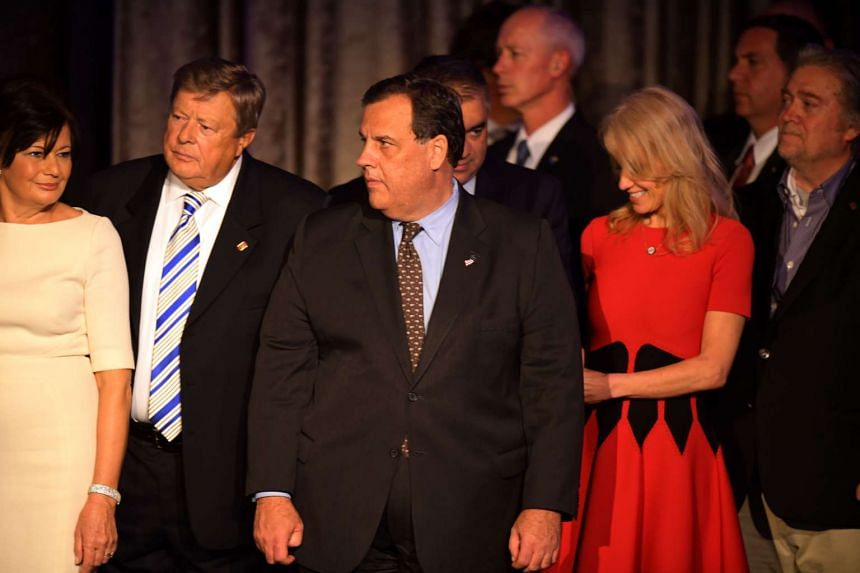 New Jersey governor Chris Christie looks on (centre) as Trump speaks during election night on Nov 9, 2016.