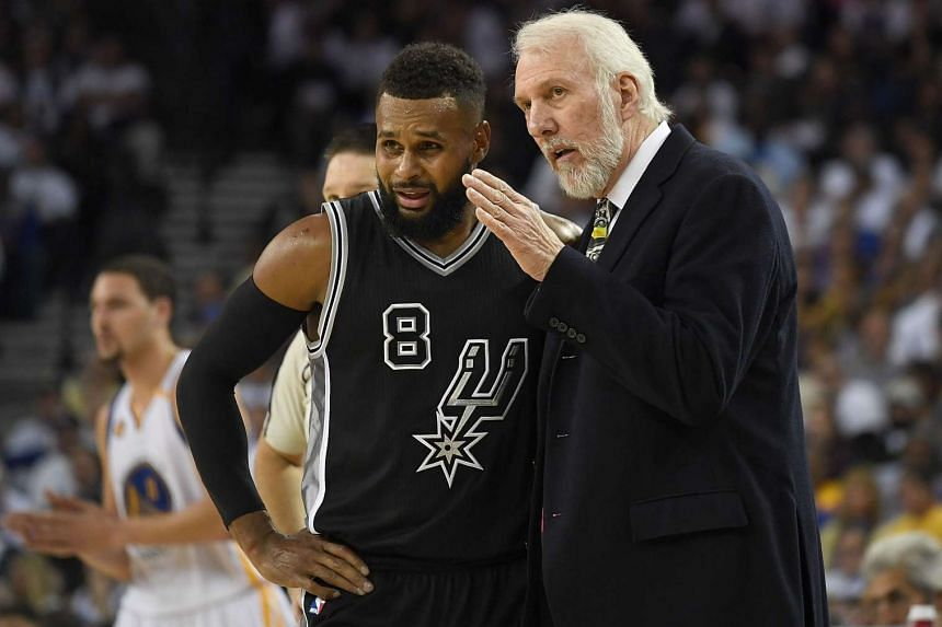 Head coach Gregg Popovich of the San Antonio Spurs talking with player Patty Mills #8 during the second quarter of an NBA basketball game against the Golden State Warriors on Oct 25, 2016.