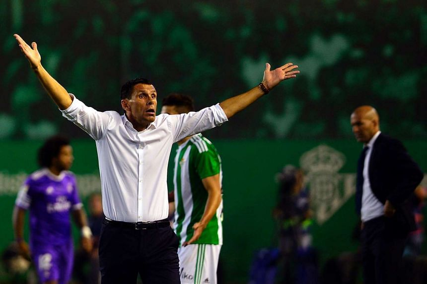 Betis' Uruguayan coach Gustavo Poyet (left) gestures on the sideline during the Spanish league football match Real Betis vs Real Madrid CF on Oct 15, 2016.