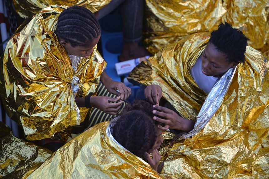 African women aboard the Topaz Responder ship run by Maltese NGO Moas and the Red Cross after a rescue operation of migrants and refugees on Nov 3, 2016.