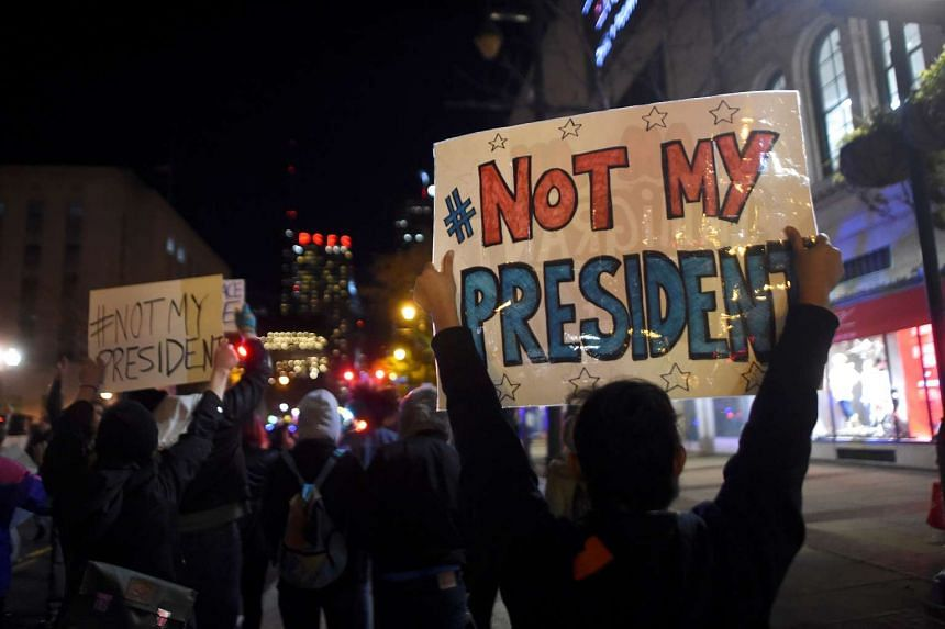 Demonstrators protest in response to the election of Republican Donald Trump as President of the United States in Philadelphia on Nov 11, 2016.