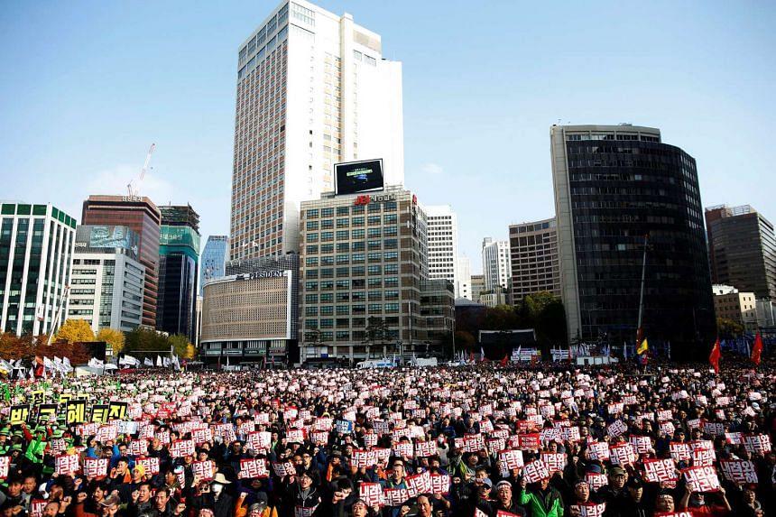 South Koreans protest against South Korean President Park Geun Hye in Seoul on Nov 12, 2016.