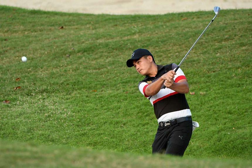 Sutijet Kooratanapisan of Thailand hitting a shot during the third round of the Resorts World Manila Masters golf tournament on Nov 12, 2016.