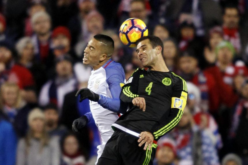 Mexico Men's National team defender Rafael Marquez (right) heading the ball against US Men's National team forward Bobby Wood during the 2018 Fifa World Cup qualifying match, on Nov11, 2016.