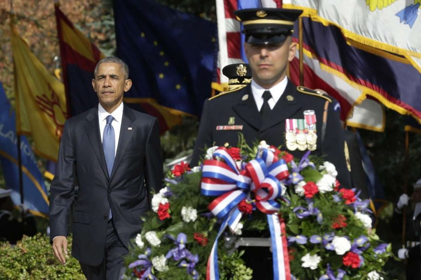 Obama participates in a wreath-laying ceremony at the Tomb of the Unknown Soldier at Arlington National Cemetery to mark Veterans Day on Nov 11, 2016.