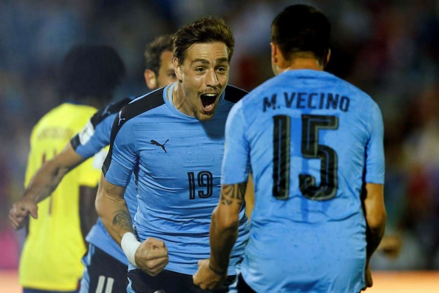 Uruguay's Sebastian Coates celebrates with team mate Matias Vecino after scoring a goal.