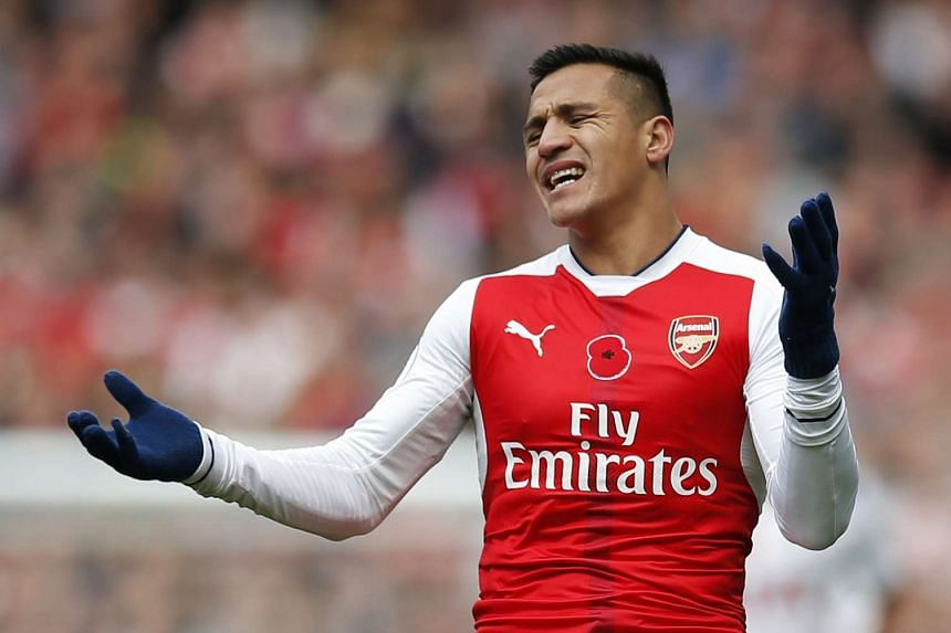 Arsenal's Alexis Sanchez reacts during the English Premier League football match between Arsenal and Tottenham Hotspur.