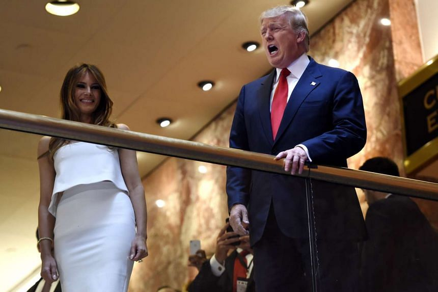 Donald Trump (right) walks with his wife Melania before announcing that he is running for president of the United States, during an event at Trump Tower in New York.