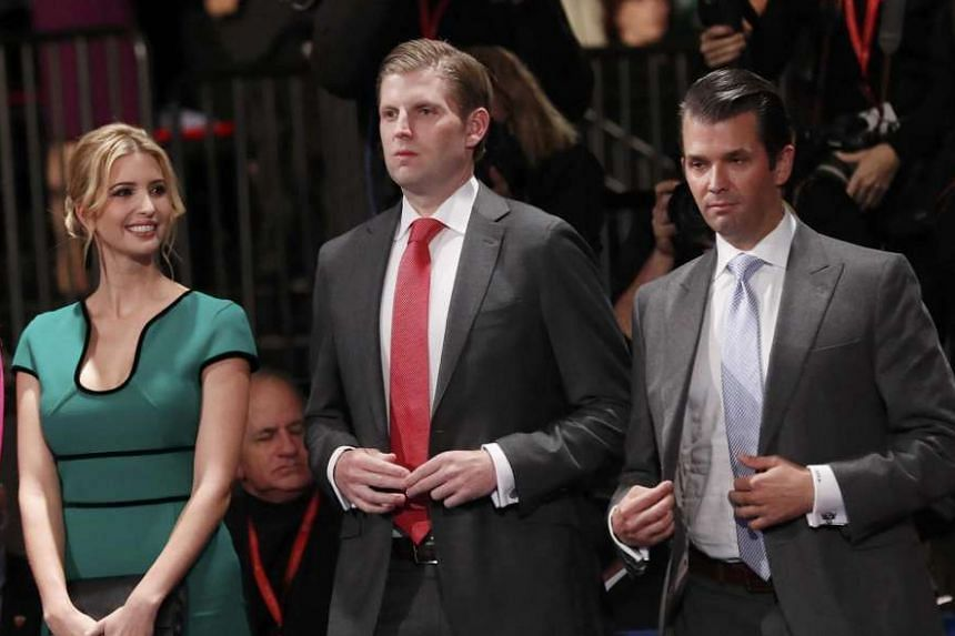(From left) Ivanka Trump, Eric Trump and Donald Trump Jr. stand before the presidential town hall debate.
