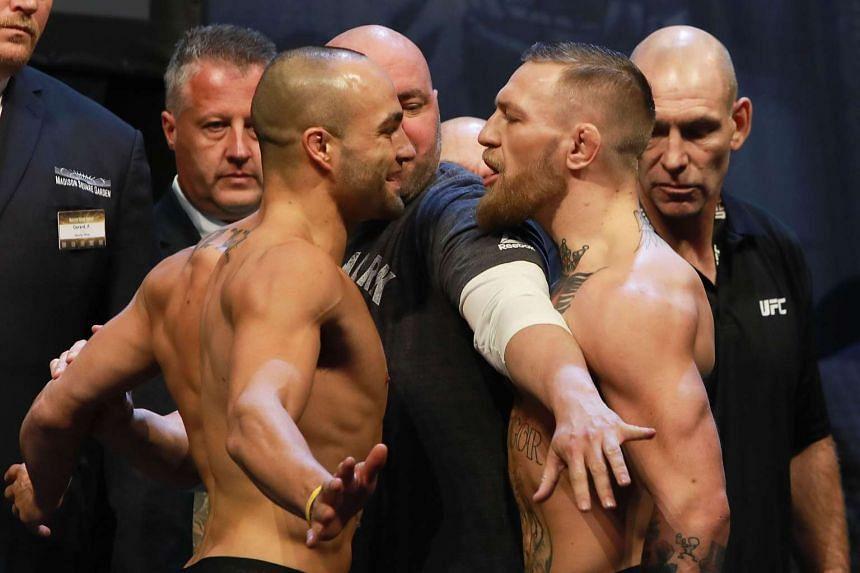 UFC president Dana White seperates UFC Featherweight Champion Conor McGregor of Ireland (right) and UFC Lightweight Champion Eddie Alvarez during UFC 205 Weigh-ins at Madison Square Garden on Nov 11, 2016.