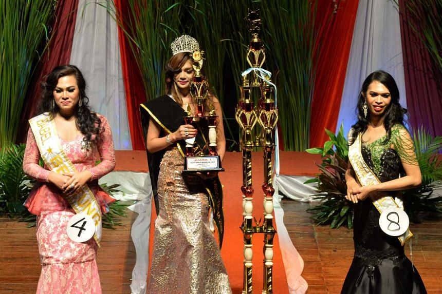 Twenty-eight-year-old Pie Nabh Tappii (centre) won the title of Miss Transgender Indonesia, facing off competition from 18 other contestants.