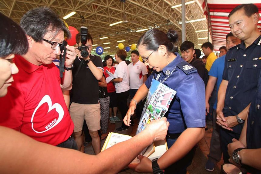East Coast GRC MP Lim Swee Say attends the launch of the Road Master Test Kit during the Bedok Community for All Ages Day.