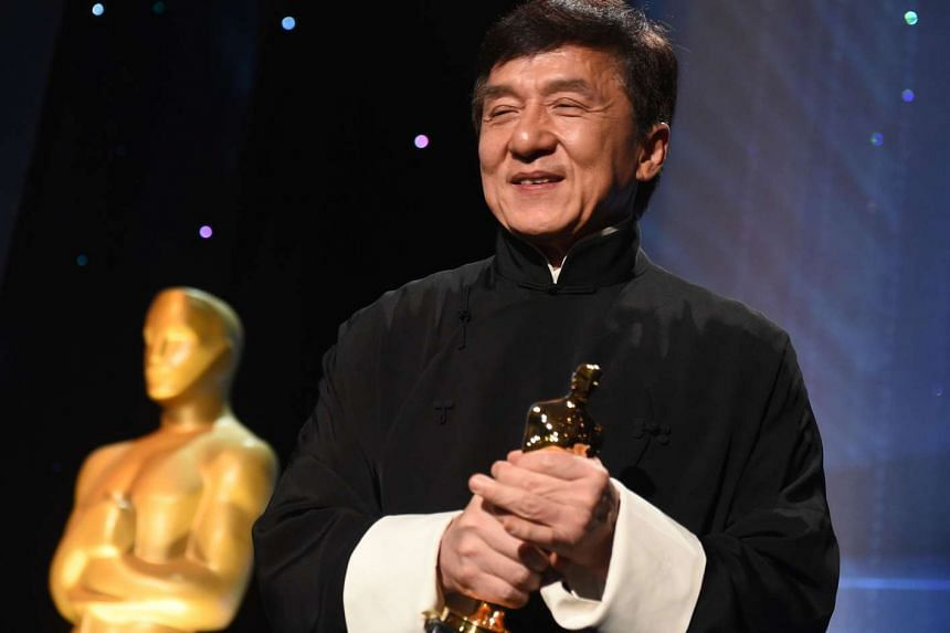 Honoree Jackie Chan poses with his Honorary Oscar Award during the 8th Annual Governors Awards hosted by the Academy of Motion Picture Arts and Sciences in Hollywood on Nov 12, 2016.