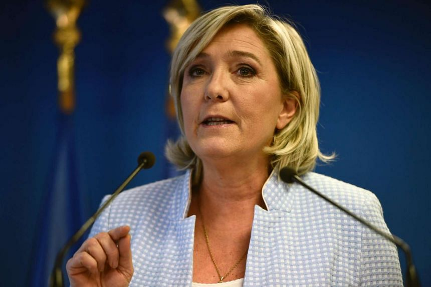 President of the French far-right party Marine Le Pen delivers a speech during a press conference on Nov 9, 2016 in the party headquarters in Nanterre.