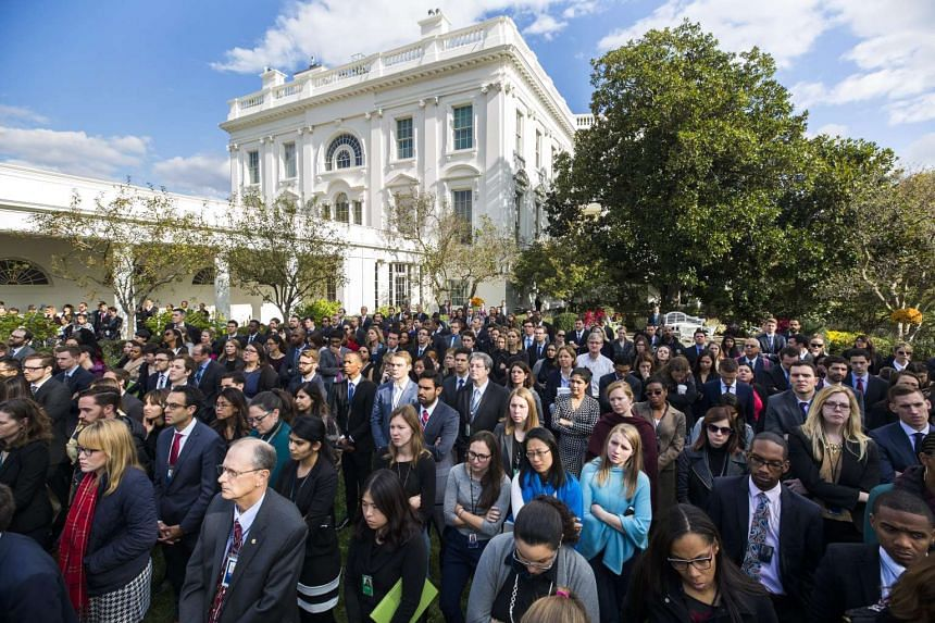 White House staff members listen to US President Barack Obama speak about Donald Trump's victory over Hillary Clinton for the presidency in the Rose Garden of the White House on Nov 9, 2016.