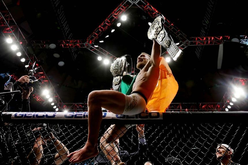 Conor McGregor celebrates his KO victory over Eddie Alvarez in their lightweight championship bout during the UFC 205 event at Madison Square Garden on Nov 12, 2016.