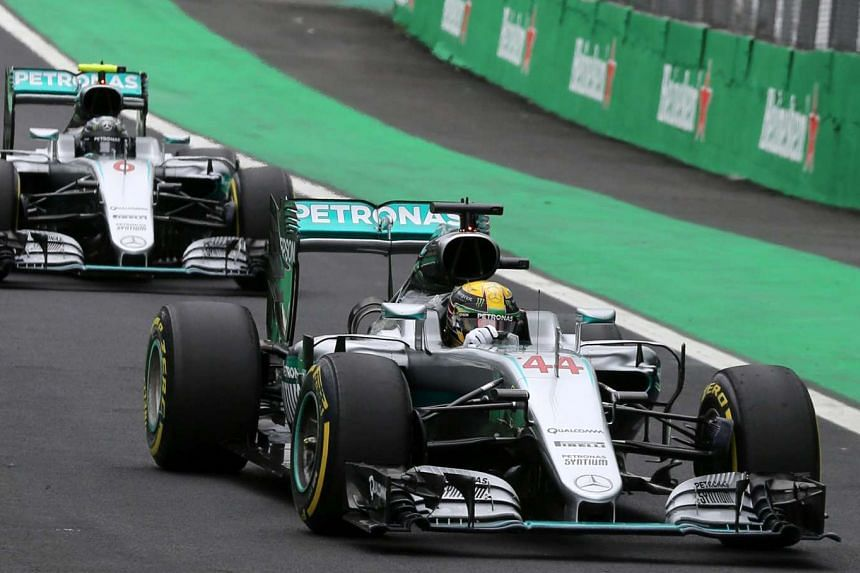 Lewis Hamilton (44) and Nico Rosberg (6) drive during the qualifying session.