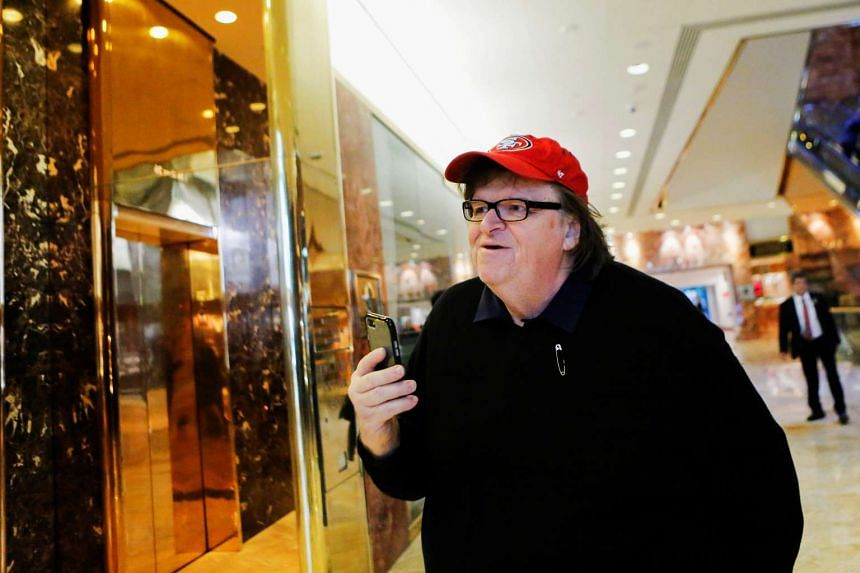 Filmmaker Michael Moore arrives at Republican president-elect Donald Trump's Trump Tower in New York.