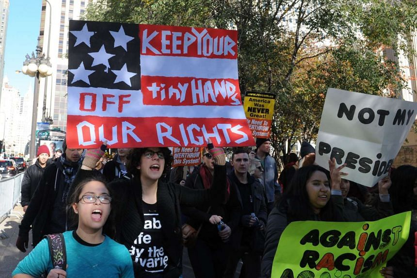 Demonstrators march in Chicago on Nov 12, 2016, to protest the election of Donald Trump.