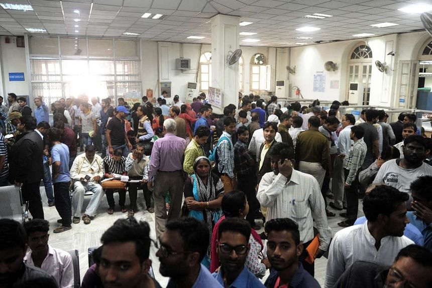 People queue inside a bank as they wait to deposit and exchange 500 and 1000 rupee notes in Allahabad, India on Nov 12, 2016.