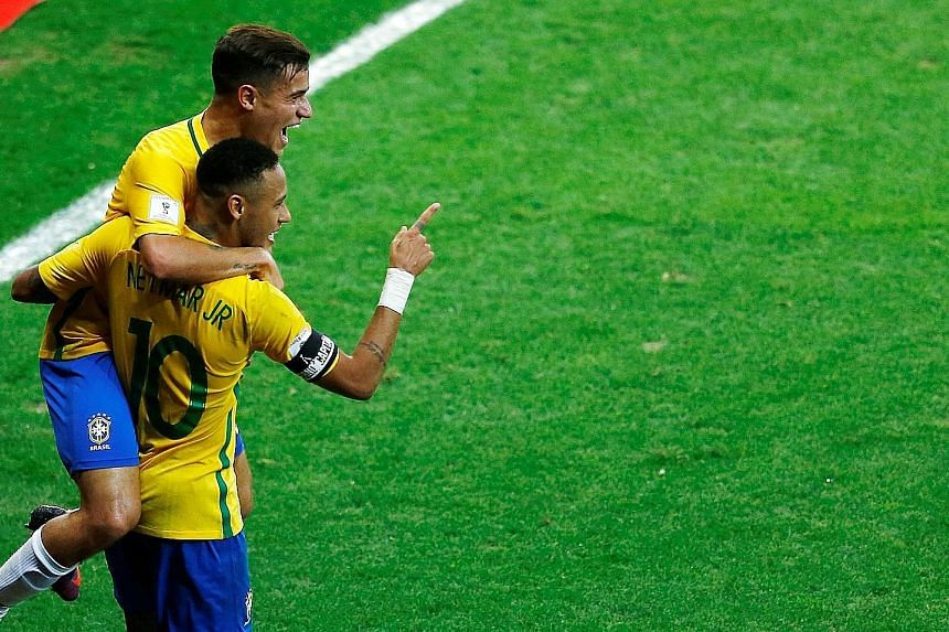"Neymar celebrating his goal in the 3-0 win over Argentina in World Cup qualifying with Philippe Coutinho. The Barca star has been hinting his club should buy his Brazil team-mate, as they are ""made to play with each other""."