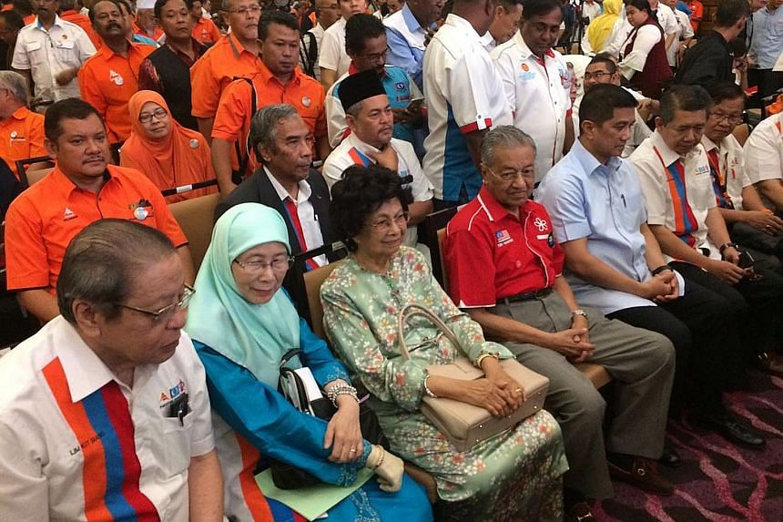 At the Pakatan Harapan convention yesterday were (front row, from left) DAP leader Lim Kit Siang, Keadilan president Datuk Seri Wan Azizah Wan Ismail, Tun Dr Siti Hasmah Mohamad Ali, her husband and former prime minister Tun Dr Mahathir Mohamad, and