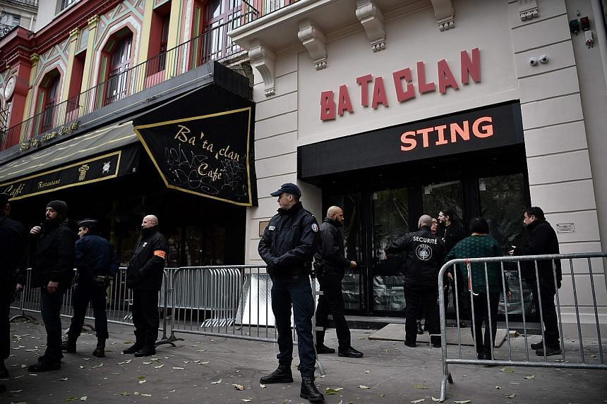 Security officers guarding the entrance of the Bataclan concert hall yesterday, hours before the reopening concert by Sting.