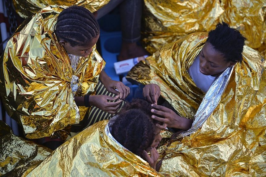 Migrant women from Africa on board a rescue ship after being found off the Libyan coast, among the hundreds who arrive in Europe every month.