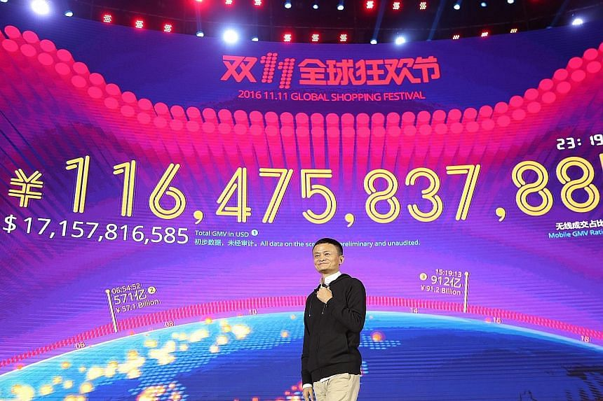 Mr Ma, founder of Alibaba, speaking in front of a screen displaying his company's sales figure during the Singles' Day festival in Shenzhen on Friday. Analysts say that although the day's turnover is only a fraction of the online retailer's total ann