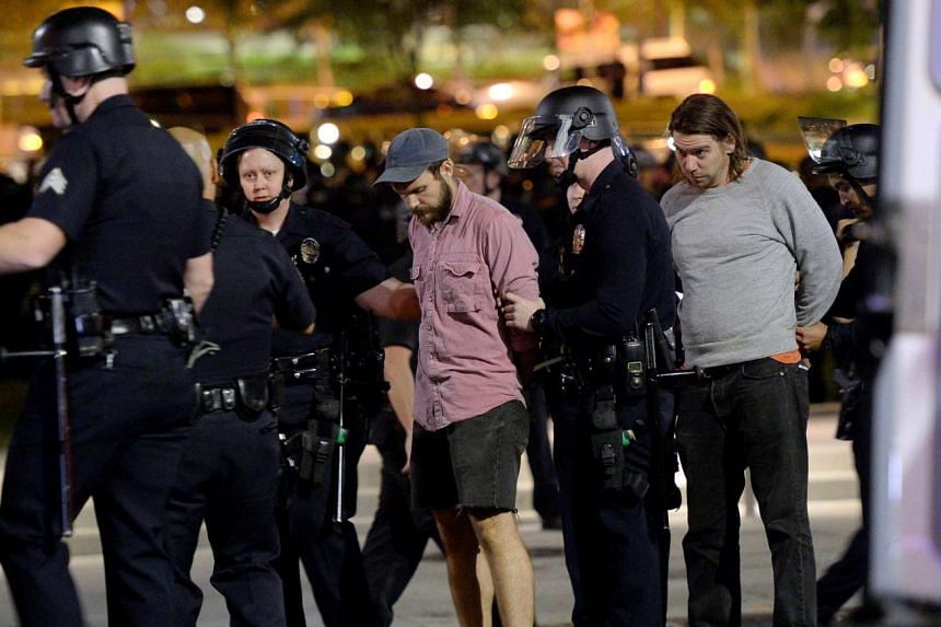 Protesters are detained by police in Los Angeles on Nov 12, 2016.