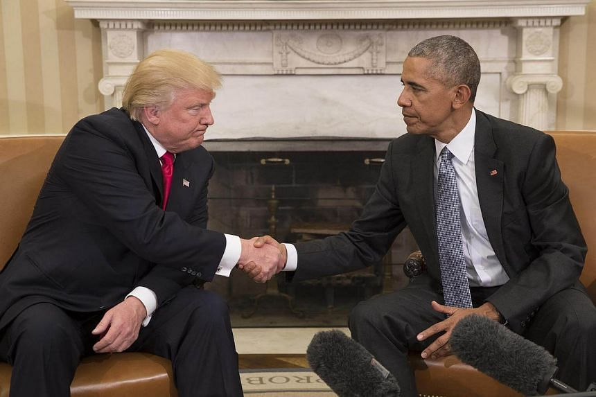 Donald Trump, the president-elect, shakes hands with President Barack Obama during a meeting in the Oval Office of the White House in Washington, on Nov 10, 2016.