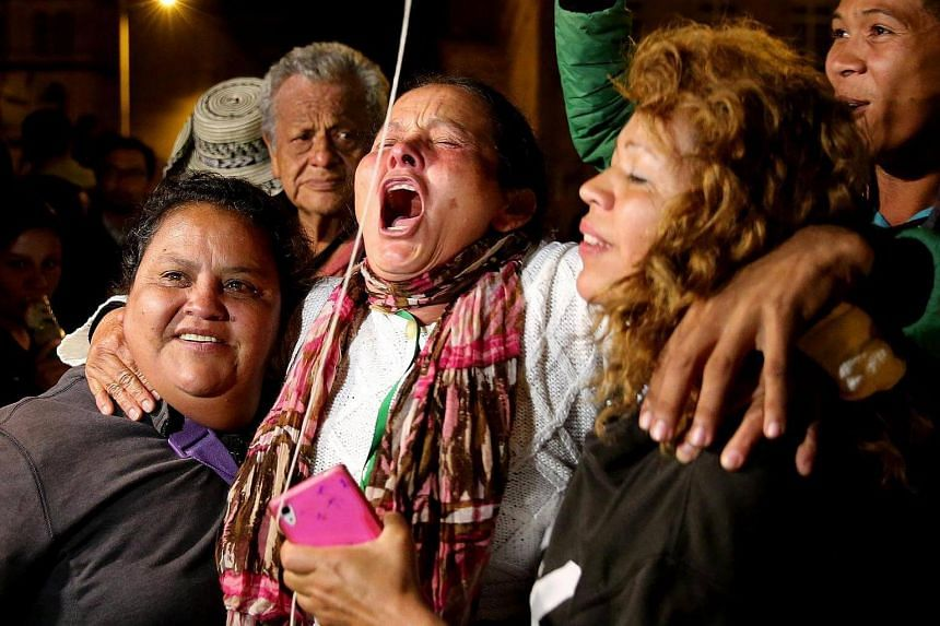 People react as they celebrate the new agreement between the Colombian Government and Colombian FARC rebel group at Plaza de Bolivar in Bogota, Colombia on Nov 12, 2016.