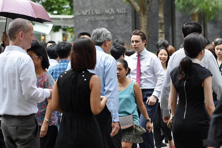 Crowd at Raffles Place in the Central Business District.