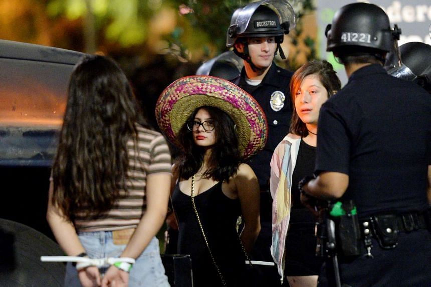 Several hundred protesters are arrested in Los Angeles, California, Nov 12, 2016.