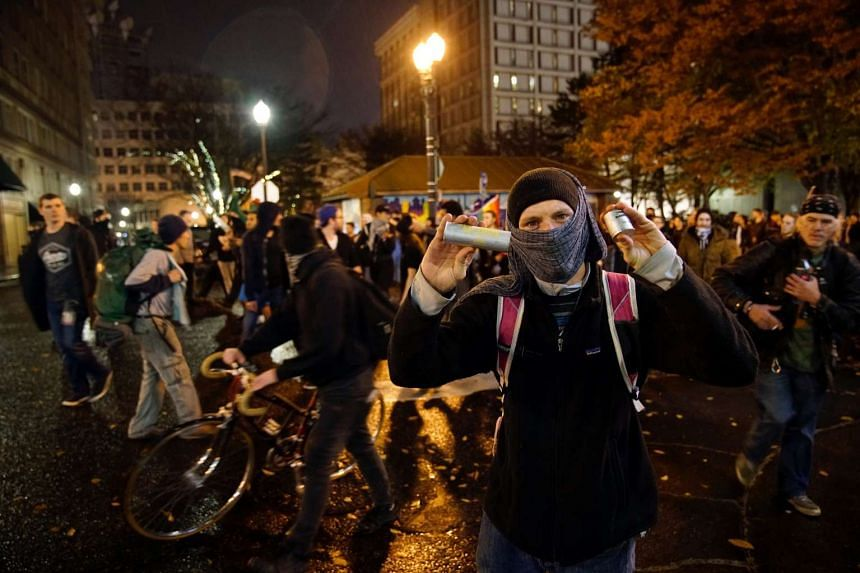 A demonstrator holds up cartridges during an anti-Trump protest in Portland, Oregon, Nov 12, 2016.
