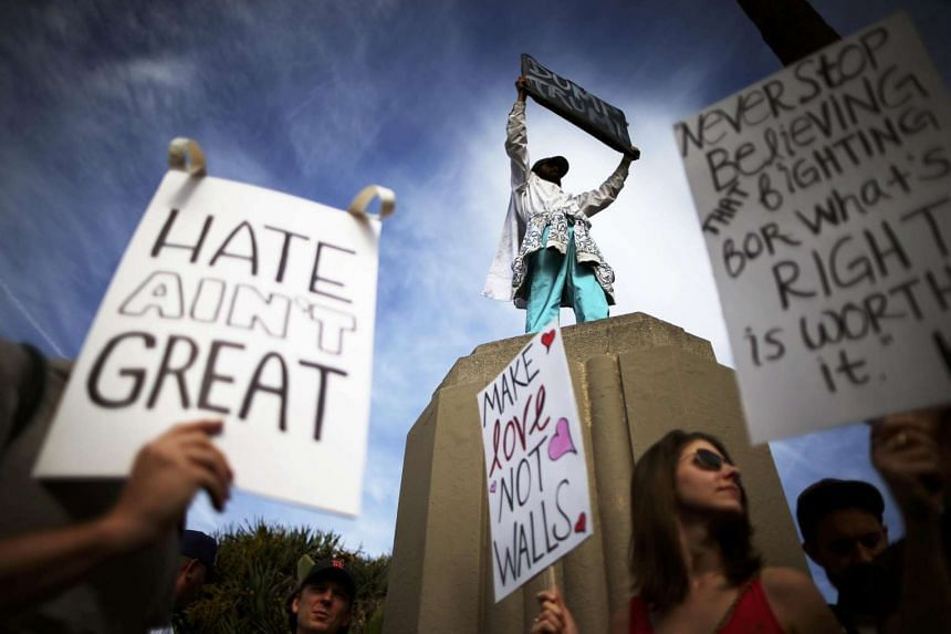 Protesters hold up anti-Trump signs in Los Angeles, California, Novr 12, 2016