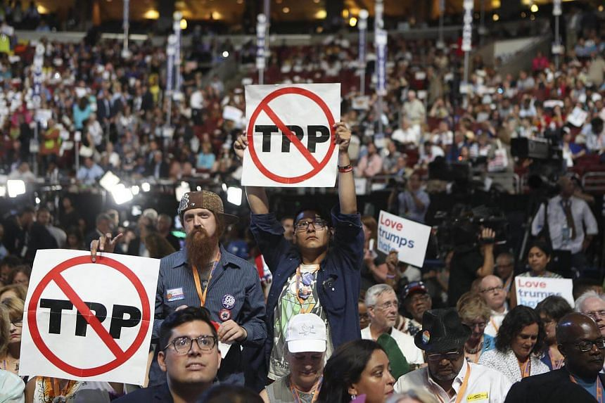 Demonstrators protest against the Trans-Pacific Partnership trade deal at the Democratic National Convention in Philadelphia on July 25, 2016.