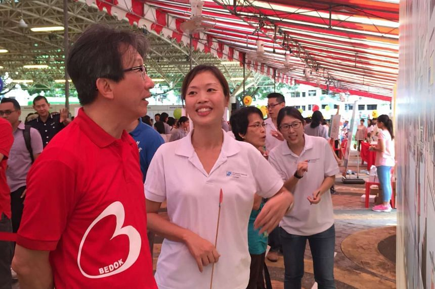 East Coast GRC MP Lim Swee Say testing his sight at Traffic Police's booth during the Bedok Community for All Ages Day.