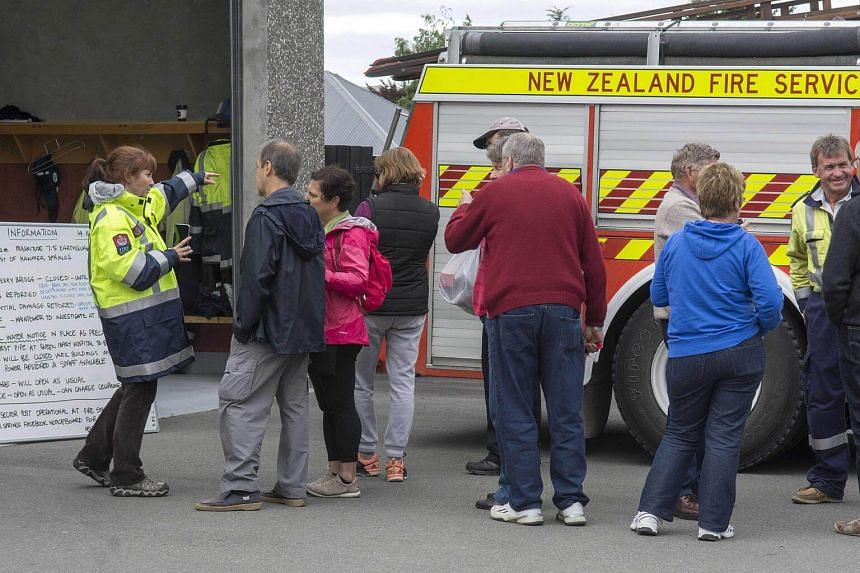 Members of the public gather by the Hanmer Springs Civil Defence information board after the 7.5 magnitude Hanmer Earthquake, New Zealand on Nov 14, 2016.