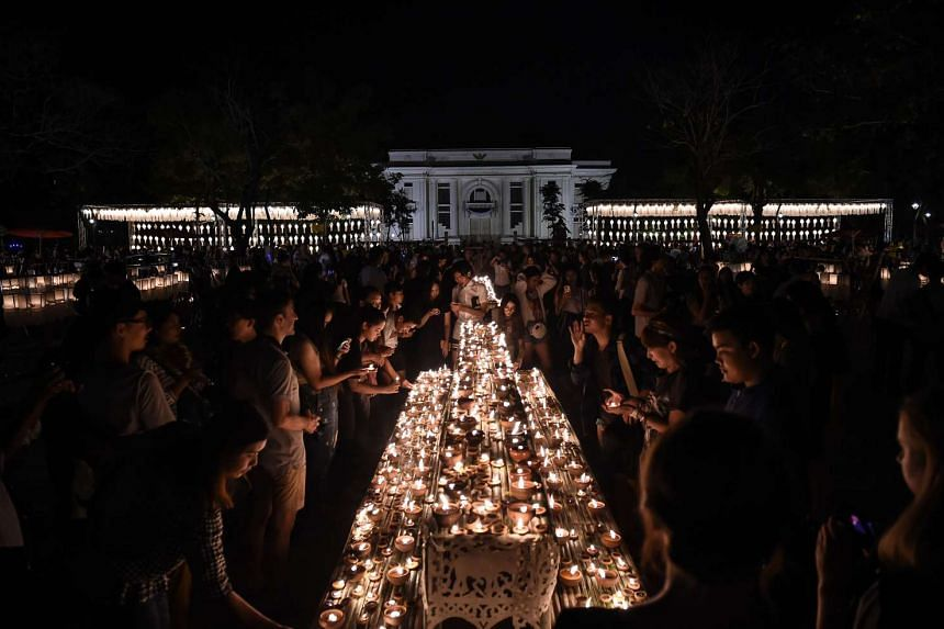 Tourists and locals light candles in the city centre to mark the beginning of the annual Yi Peng festival in the popular tourist city of Chiang Mai in the north of Thailand on Nov 13, 2016.